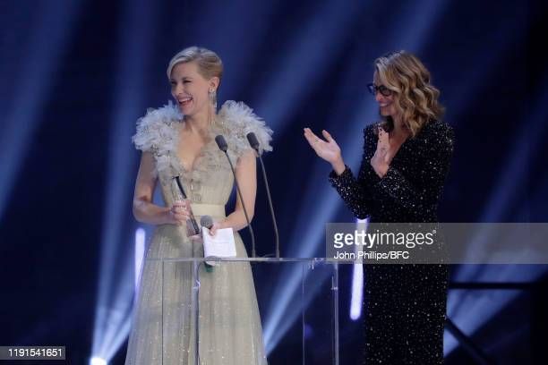 Cate Blanchett and Julia Roberts on stage during The Fashion Awards 2019 held at Royal Albert Hall on December 02 2019 in London England