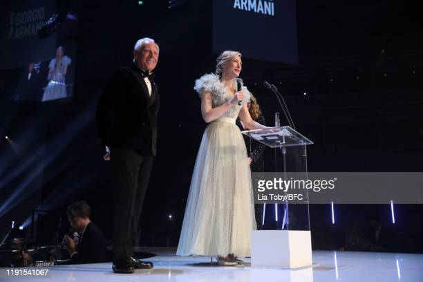 Cate Blanchett and Julia Roberts present the Outstanding Achievement award to Giorgio Armani on stage during The Fashion Awards 2019 held at Royal...