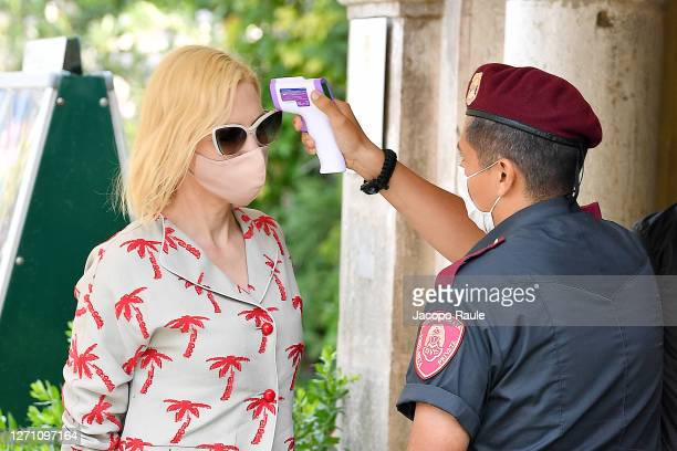 Cate Blanchett has her temperature checked as she arrived at the Excelsior during the 77th Venice Film Festival on September 07, 2020 in Venice,...