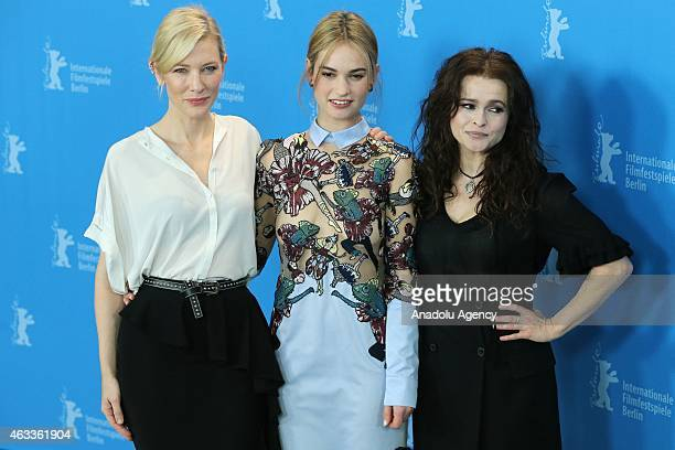 Cate Blanchett Lily James and Helena Bonham Carter pose during a photocall of 'Cinderalla' at the 65th Berlinale International Film Festival in...