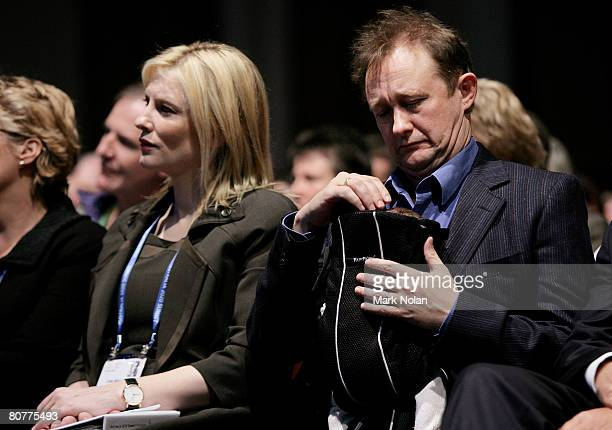 Cate Blanchett of Australia listens to speakers in the Great Hall as husband Andrew Upton cares for their new son Ignatius Martin Upton during day...