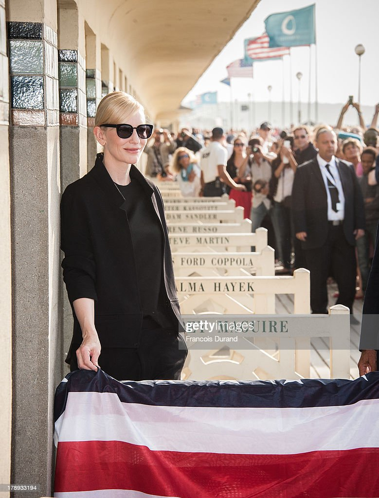 Cate Blanchett poses next to the beach closet dedicated to her at a photocall on the Promenade des Planches during the 39th Deauville American Film Festival on August 31, 2013 in Deauville, France.