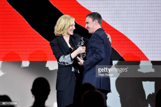 Cate Blanchett presents the 2018 CFDA Womenswear Designer of The Year award to Raf Simons during the 2018 CFDA Fashion Awards Winners Walk at...