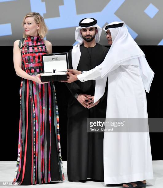 Cate Blanchett reacts on stage after receiving her Honorary Award with HH Sheikh Mansoor bin Mohammed bin Rashid Al Maktoum and DIFF Chairman...