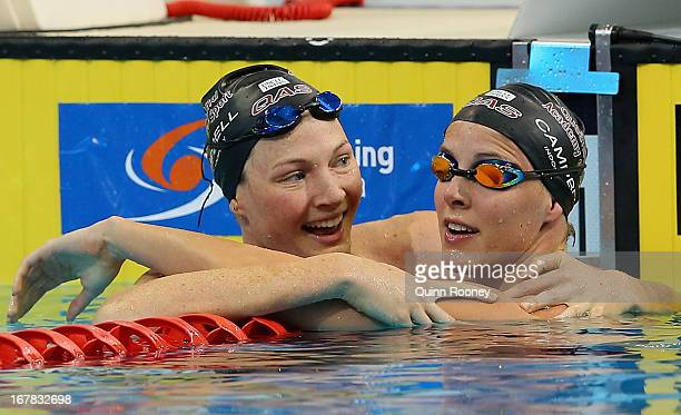 Cate Campbell and Bronte Campbell of Australia celebrate finishing first and second in the Women's 100 Metre Freestyle during day six of the...
