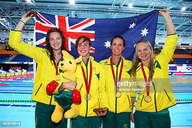 Cate Campbell Bronte Campbell Emma McKeon and Melanie Schlanger of Australia celebrate winning the gold medal after the medal ceremony for the...