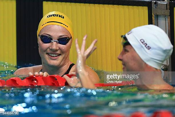 Cate Campbell celebrates winning while Bronte Campbell celebrates second place in the 50 Metre Freestyle during the 2016 Australian Swimming Grand...