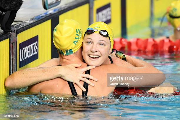 Cate Campbell of Australia and Bronte Campbell of Australia embrace following the Women's 50m Freestyle Final on day three of the Gold Coast 2018...