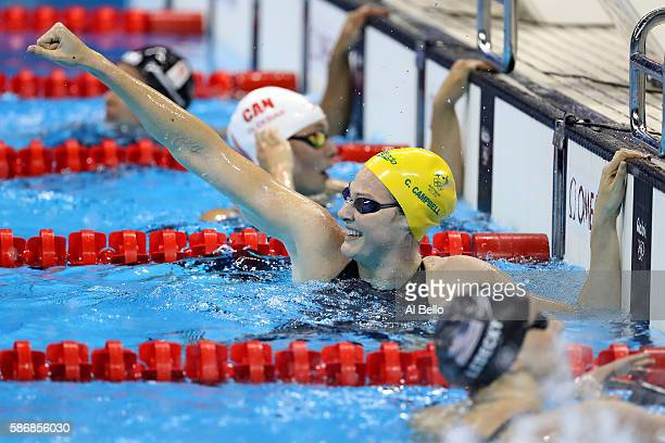 Cate Campbell of Australia celebrates winning gold and a new world record in the Final of the Women's 4 x 100m Freestyle Relay on Day 1 of the Rio...