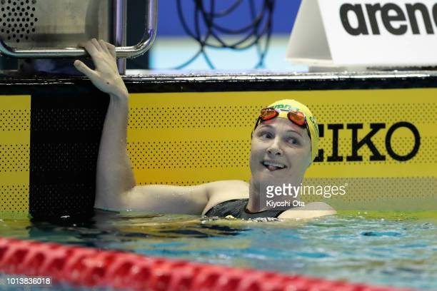 Cate Campbell of Australia celebrates winning the gold medal after competing in the Mixed Medley Relay Final on day one of the Pan Pacific Swimming...