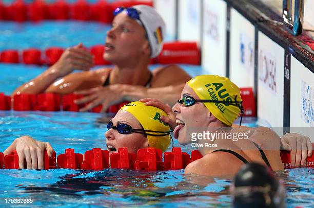 Cate Campbell of Australia celebrates with Bronte Campbell of Australia after the Swimming Women's Freestyle 50m Semifinal heat 2 on day fifteen of...