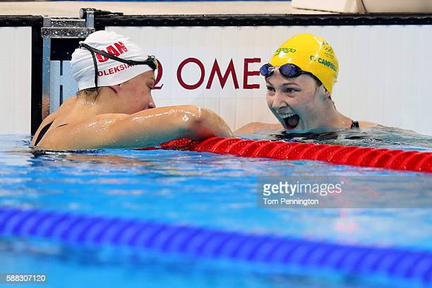 Cate Campbell of Australia celebrates with Penny Oleksiak of Canada in the second Semifinal of the Women's 100m Freestyleon Day 5 of the Rio 2016...