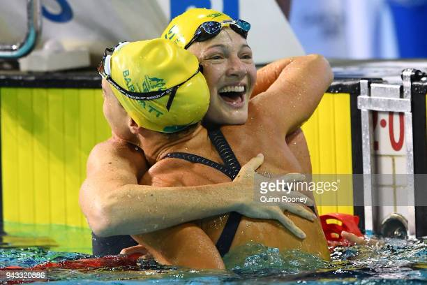 Cate Campbell of Australia embraces teammate Holly Barratt as she celebrates victory in the Women's 50m Butterfly Final on day four of the Gold Coast...