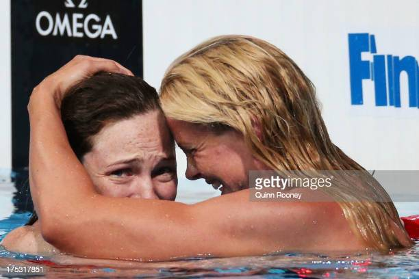 Cate Campbell of Australia is congratulated by Britta Steffen of Germany after the Swimming Women's Freestyle 100m Final on day fourteen of the 15th...