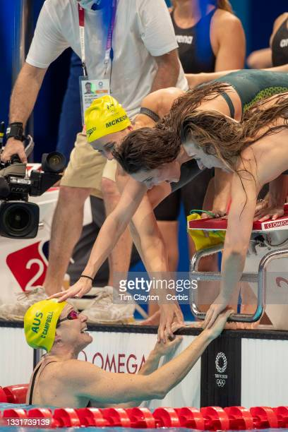 Cate Campbell of Australia is congratulated by team mates Kaylee McKeown, Chelsea Hodges and Emma McKeon after her anchor leg swim secured victory...