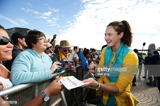 Cate Campbell signs autographs for fans during the Australian Olympic Team Welcome Home Celebration at Sydney Opera House on August 29 2016 in Sydney...