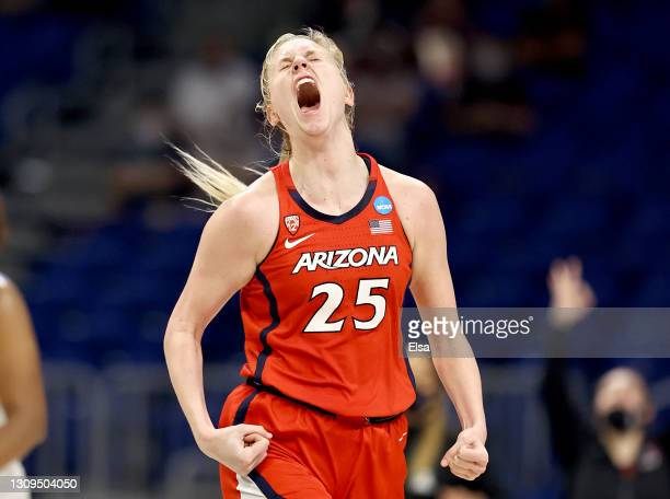 Cate Reese of the Arizona Wildcats reacts after she hit a three point shot in the second half against the Texas A&M Aggies during the Sweet Sixteen...
