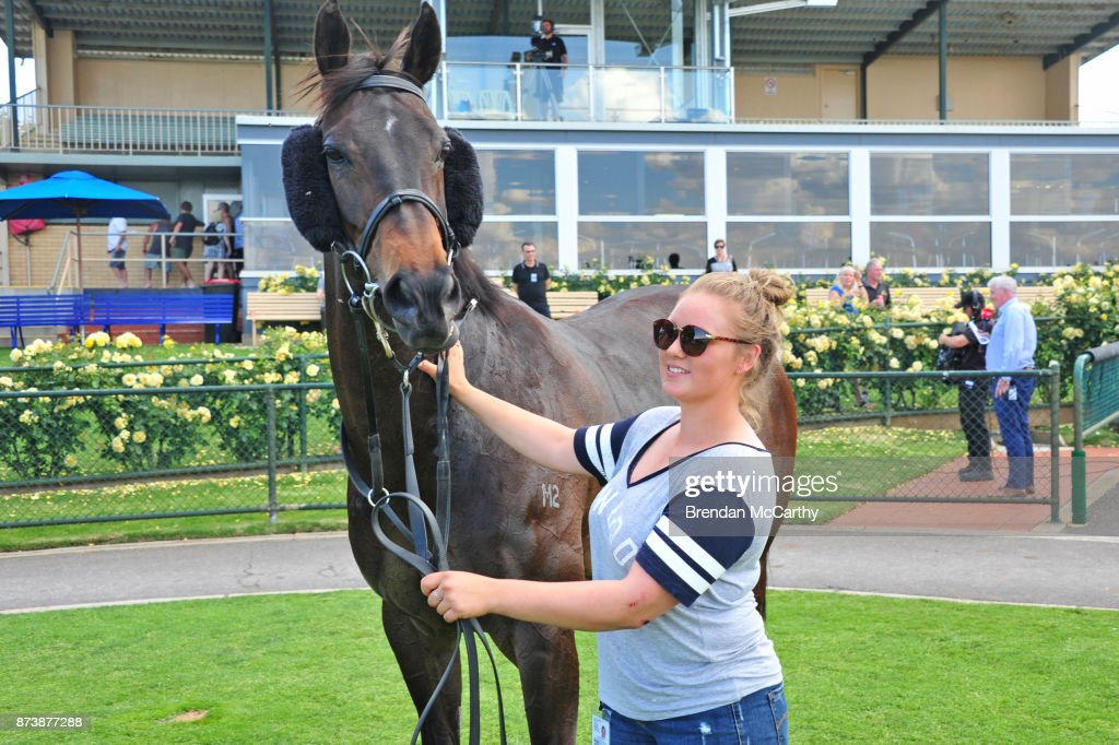 Catechesis and strapper Erin Kirkpatrick after winning the Roll the Dice BM64 Handicap at Bendigo Racecourse on November 14, 2017 in Bendigo, Australia.