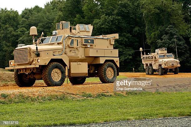 Category I and Category II Mine Resistant Ambush Protected vehicle drive through an offroad course during a demonstration at Aberdeen Proving Ground...