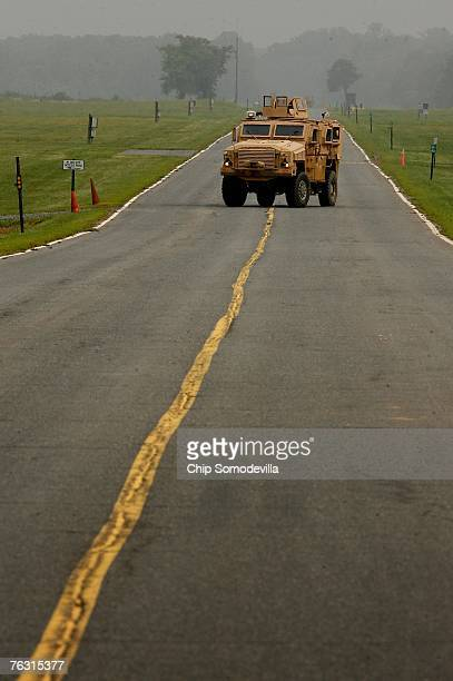 Category I Mine Resistant Ambush Protected vehicle drives across a paved road during a demonstration at Aberdeen Proving Ground on Friday August 24...