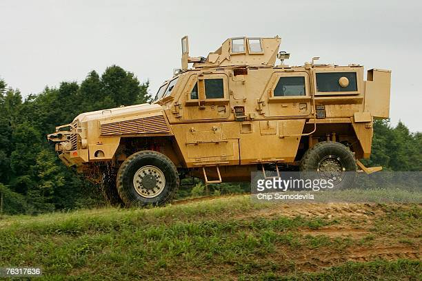Category I Mine Resistant Ambush Protected vehicle drives through an offroad course during a demonstration at Aberdeen Proving Ground on Friday...