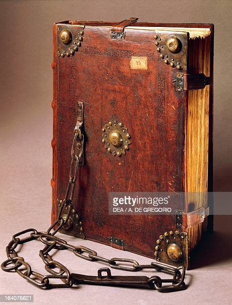 Catenate code Code manuscript of the Statutes of Asti in 1379 with the city laws Binding wood covered with leather and decorated with brass studs...