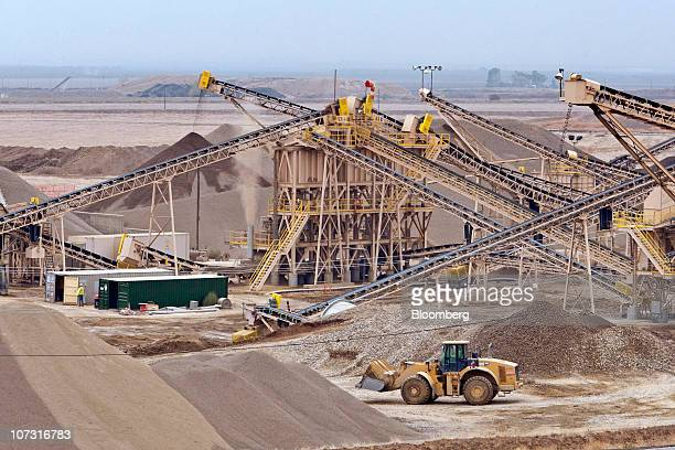 A Catepillar bulldozer moves aggregate at Granite Construction Inc's Hot Mix and Aggregate Vernalis plant in Tracy California US on Thursday Dec 2...