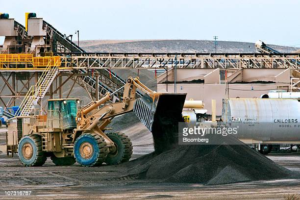 A Catepillar bulldozer moves hot mix material at Granite Construction Inc's Hot Mix and Aggregate Vernalis plant in Tracy California US on Thursday...