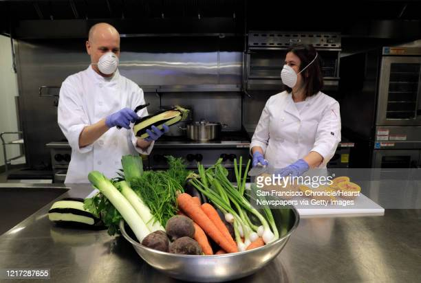 Caterer Aliza Grayevsky Somekh right and her husband Nadav Somekh prepare vegetables for takeaway Seder plates in the kitchen at Temple Beth Abraham...