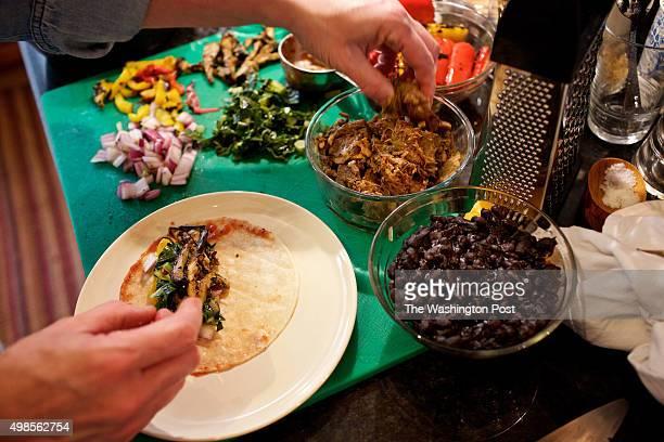 WASHINGTON DC Caterer Anna Saint John's leftover creations adding ingredients for refrigerator enchiladas photographed in Washington DC