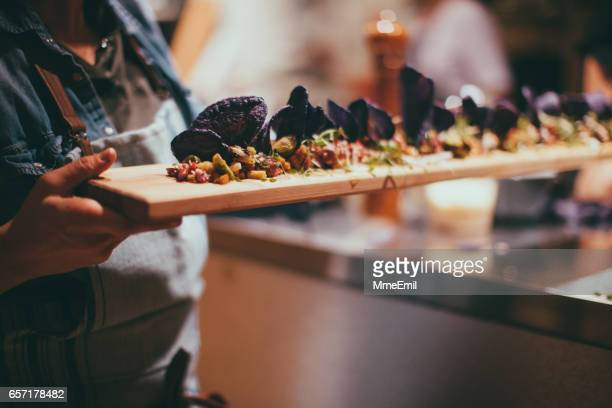 caterer cooking - tapas stock photos and pictures
