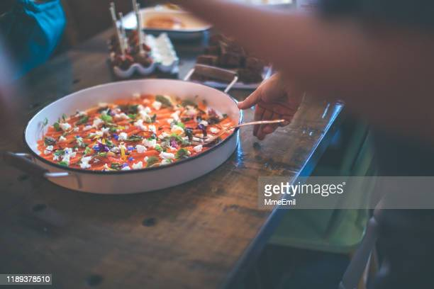 caterer serving a large plate of gravlax - mmeemil stock photos and pictures