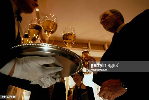 Caterers from Feast and Fetes Catering work at a French Embassy party in New York City