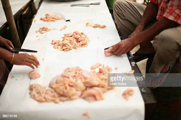 Caterers prepare raw chicken for a function being held at the Rock Garden on March 26 2010 in Chandigarh India The 12acre Rock Garden which began as...