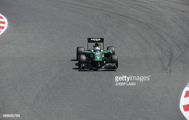 Caterham F1 Team's Japanese driver Kamui Kobayashi drives during the second practice session at the Circuit de Catalunya on May 9, 2014 in Montmelo...