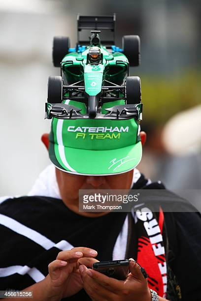 Caterham fan attends Qualifying for the Japanese Formula One Grand Prix at Suzuka Circuit on October 4, 2014 in Suzuka, Japan.
