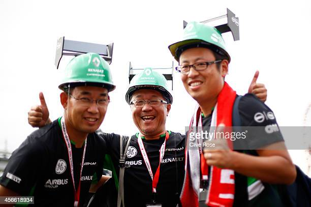 Caterham fans pose for the camera during Qualifying for the Japanese Formula One Grand Prix at Suzuka Circuit on October 4 2014 in Suzuka Japan