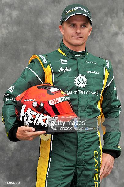 Caterham-Renault driver Heikki Kovalainen of Finland poses for the official driver's portrait ahead of Formula One's Australian Grand Prix in...
