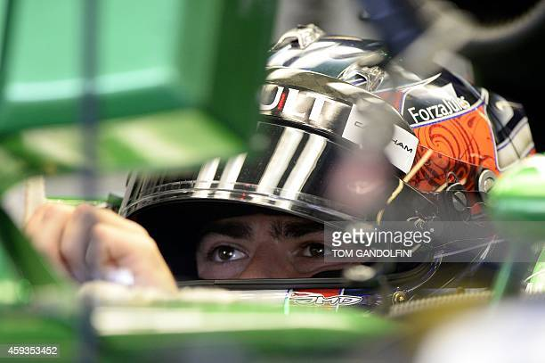 Caterhams' British driver Will Stevens looks at a control screen in the pits during the first practice session at the Yas Marina circuit in Abu Dhabi...