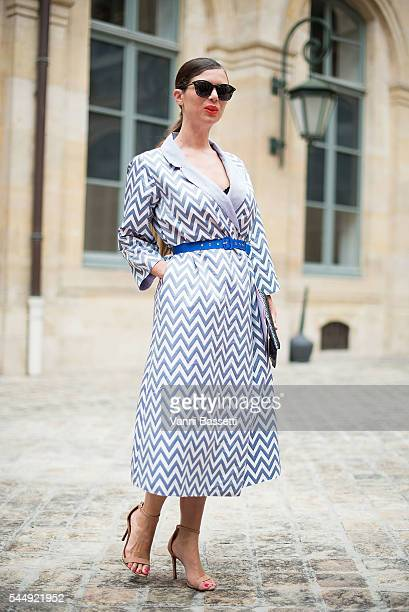 Caterina Minthe poses wearing a Daneh coat before the Schiaparelli show in Place Vendome during Paris Fashion Week Haute Couture FW 16/17 on July 4...