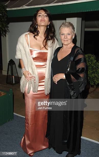 Caterina Murino and Dame Judi Dench during 'Casino Royale' World Premiere After Party Inside at Berkeley Square in London Great Britain