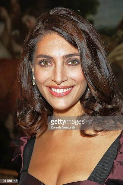 Caterina Murino attends the Dolce Gabbana show as part of Milan Womenswear Fashion Week Spring/Summer 2010 on September 27 2009 in Milan Italy