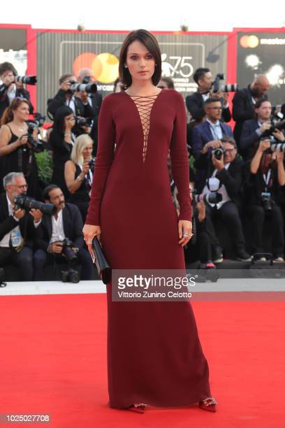 Caterina Shulha walks the red carpet ahead of the opening ceremony and the 'First Man' screening during the 75th Venice Film Festival at Sala Grande...