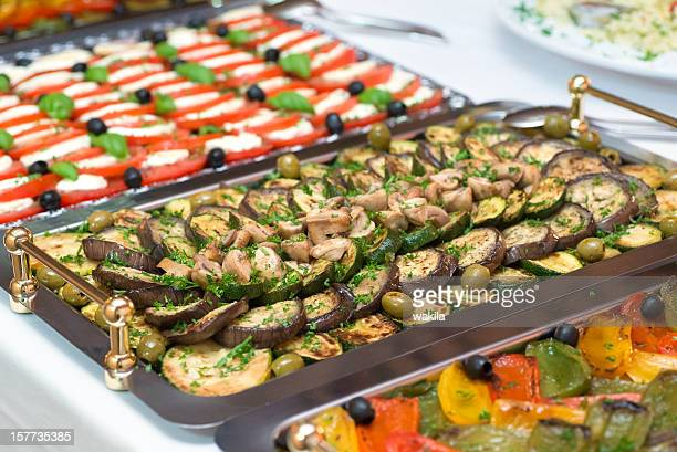 catering buffet on wedding with aubergine and calabrese