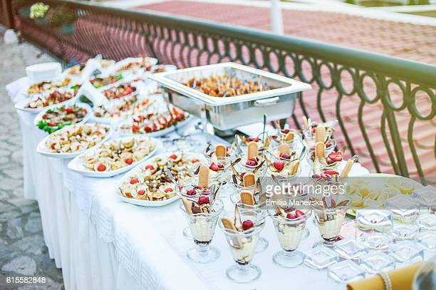 Catering service. Restaurant table with food at event