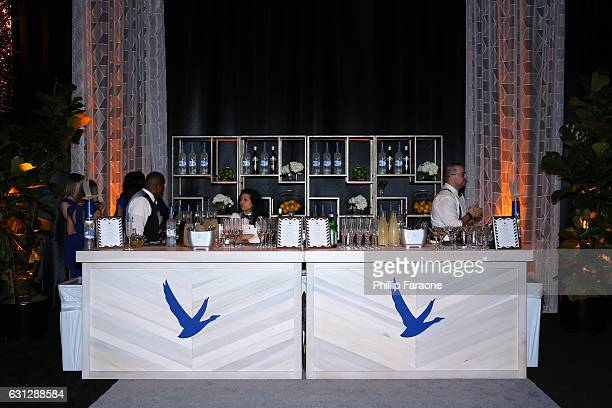 Catering staff prepare a bar at The Weinstein Company and Netflix Golden Globe Party, presented with FIJI Water, Grey Goose Vodka, Lindt Chocolate,...