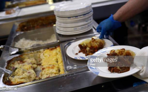 Catering staff prepare lunchtime meals for patients in the kitchen at The Royal Blackburn Teaching Hospital in East Lancashire during the current...