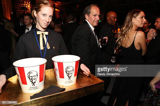 Catering staff serve buckets of KFC during The Weinstein Company and Netflix Golden Globe Party presented with FIJI Water Grey Goose Vodka Lindt...