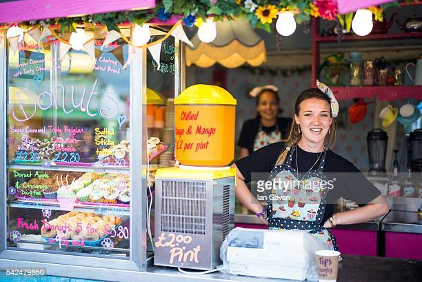 Catering staff work in a fast food store at the Glastonbury Festival at Worthy Farm Pilton on June 23 2016 in Glastonbury England Now its 46th year...