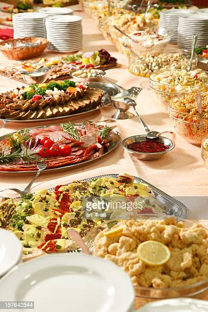 Catering table full of appetizing foods